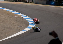 Stoner chases Valentino in the corkscrew